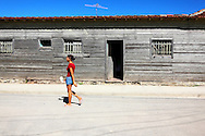 Woman and house in Campechuela, Granma, Cuba.