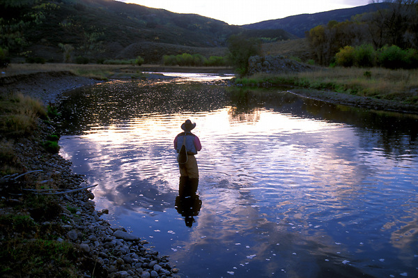 Fisherman flyfishing on the upper yampa near steamboat for Fishing colorado springs