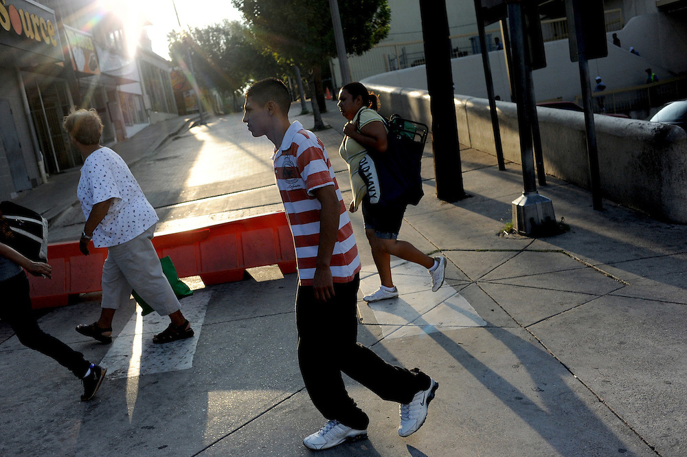 Pedestrians from Mexico cross into the center of Laredo, Texas on August 19, 2010 in the early morning. City officials say negative attitudes about the city's more dangerous sister Nuevo Laredo have kept tourists from coming and effected the over all economics of the town. Laredo also depends heavily on tourism from Mexico, as people from northern Mexico come to the border city to make purchases on merchandise like designer clothes that they cannot find cheaply in their country, but since Mexico's border region has become increasingly violent, store owners in Laredo, Texas say Mexican shoppers are staying home.