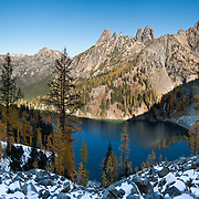 """Larch tree needles turn yellow in the first half of October on Blue Lake Trail #314, Okanagon National Forest, North Cascades Highway 20, Washington, USA. Liberty Bell Mountain (center left, 7790 feet), Early Winters Spires (center right, 7807 feet). Published in """"Light Travel: Photography on the Go"""" book by Tom Dempsey 2009, 2010. Panorama stitched from 8 overlapping images."""