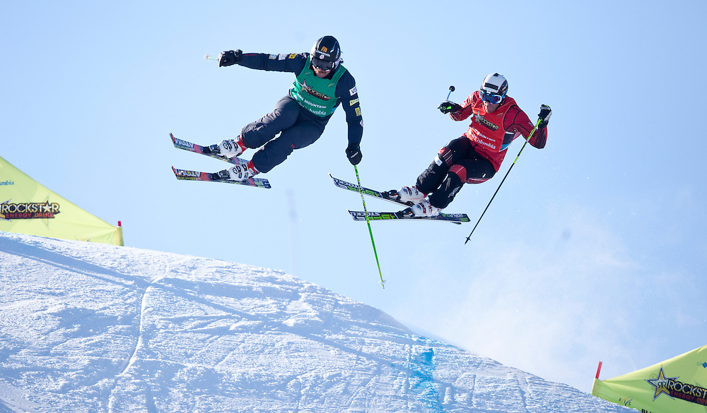 -20110211- Collingwood, Ontario,Canada -- Tomas Kraus, left, of the Czech Republic leads Canada's Christopher Delbosco during the semi final of the Rockstar Ski Cross Grand Prix race at Blue Mountain in Collingwood, Ontario, February 11, 2011.<br /> AFP PHOTO/Geoff Robins