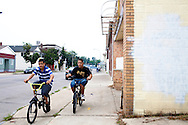 Kids ride their bikes in South Buffalo, NY, on Wednesday, July 29, 2009.