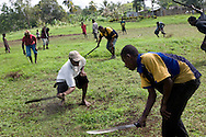 Cutting the grass on the airstrip, for forthcoming Independence Day Celebrations, Ihu village, Vailala Block 3 logging concession, Gulf Province, Papua New Guinea, Tuesday 9th September 2008.