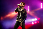 Tom Meighan of Kasabian performs live on the main stage during day three of the Isle of Wight Festival 2011 at Seaclose Park on June 12, 2011 in Newport, Isle of Wight.  (Photo by Simone Joyner)