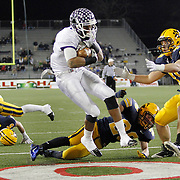 Pickerington Central wide receiver Roger Lewis (11) catches a touchdown pass behind St. Ignatius defenders Zach Baker (49), Adam North (28) andChad Aerni (5) during the Div. I state football championship against St. Ignatius at Fawcett Stadium in Canton on Dec. 3, 2011.