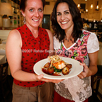 Executive chef Anna Cox Young (left0 and owner Stacey Sosa  with one of Estancia 460's dishes, a plate of Salmon with Pomegranate Orange Glaze and Frizzled Leeks. Shot at the restaurant on May 25th, 2007..Photo Credit; Rahav Segev/Photopass