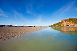 Extensive mud flats are revealed at low tide near Naturalist Island at the mouth of the Hunter River.