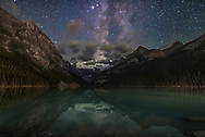 The summer Milky Way to the southwest over Victoria Glacier and Lake Louise in Banff National Park, Alberta on a moonless night, August 29, 2016. The bright star at top is Altair. This was about 2 am at the end of the night, and after a time-lapse sequence. <br /> <br /> Mt. Fairview to the left and others are partly illuminated by light spill from the Chateau Lake Louise and from highway lights in the valley below. <br /> <br /> This is a stack of 4 exposures for the ground, averaged to smooth noise, and one exposure for the sky, all 30 seconds at f/2 with the 20mm Sigma Art lens and at ISO 3200 with the Nikon D750. All untracked. Long Exposure Noise Reduction applied.