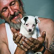 Anthony Riccio holds his puppy Precious.