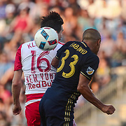 Philadelphia Union Defender FABIO ALVES (33) and New York Red Bulls Midfielder SACHA KLJESTAN (16) fight for the ball in the first half of a Major League Soccer match between the Philadelphia Union and New York Red Bulls Sunday, July. 17, 2016 at Talen Energy Stadium in Chester, PA.
