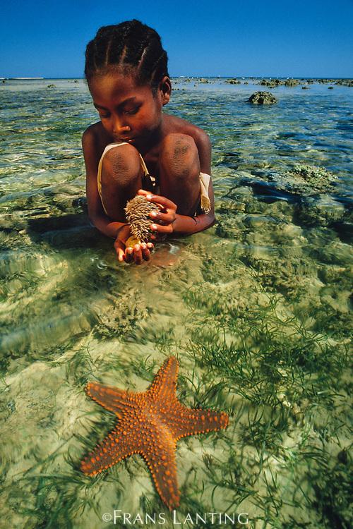 Vezo girl collecting sea urchins in lagoon, Western Madagascar