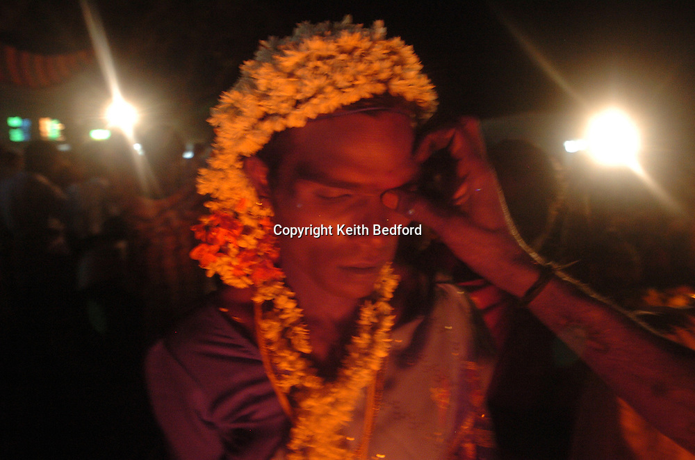 Transvestites preparer to marry the god Aravan to celebrate the Aravani festival in the town of Koovagam in the Tamil Nadu state of India April 20, 2005. After being symbolically married to the god for one night, those that participate are widowed the next morning. The festival, popular among Indian transvestites, celebrates myth of the marriage of the Hindu Lord Aravan to Lord Krishna, who transformed himself into a woman as a reward to Aravan for sacrificing himself to ensure victory during war.<br />  <br /> <br /> Photo by Keith Bedford