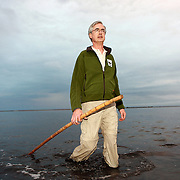 Jim Leape, director-general of WWF international, during a flamingo banding operation on july 27, 2011, in the Camargue, southern France.