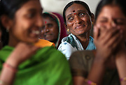An older ex-Devadasi woman smiles during a self-help group meeting in Karnataka, India, sponsored by Vimochana Sangha, a non-governmental organization founded to dismantle the Devadasi system. Self-help groups are one of the numerous empowerment tools available to Devadasi women to try to break away from the destructive cycle of the Devadasi tradition.