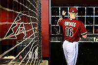 PHOENIX, AZ - AUG 30: D-backs infielder Chris Owings puts his bats in the bat rack prior to the game against the A's. (Photo by Jennifer Stewart/Arizona Diamondbacks)