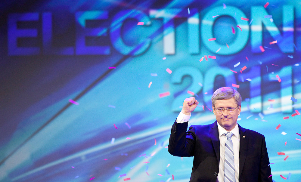 Conservative leader Stephen Harper waves to supporters at the Telus Convention Centre in Calgary, Alberta, May 2, 2011 as he celebrates the election of a Conservative majority government in Canada's federal election.<br /> AFP/GEOFF ROBINS/STR