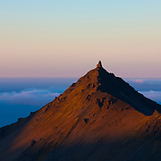 Stapafell, a 1,726-foot (526-meter) peak, reaches above the clouds on the Snæfellsnes peninsula in western Iceland.