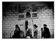 17..Mulsim Maghrebi family walk past Jewish synagogue in Belleville.
