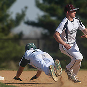 St. Marks Outfielder Jeremy Vogel (4) slides into second base head first during the third inning of a regular season baseball game between the St. Marks Spartans and Caravel Academy at St. Marks Stadium Thursday April 14, 2016 in Wilmington.