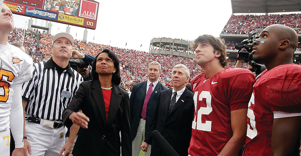 (From Left) Tenneesee quarterback Rick Clausen, referee Thomas Ritter, Secretary of State Condoleezza Rice, British Foreign Secretary Jack Straw, Alabama Quarterback Brodie Croyle (12) and DeMeco Ryans (35) look up at the coin during the coin toss before the Alabama-Tenneesee game Saturday. / Elliot Knight