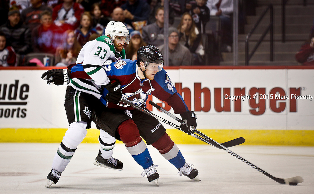 SHOT 1/10/15 4:13:22 PM - The Colorado Avalanche's Gabriel Landeskog #92 tries to fight off the Dallas Stars' Alex Goligoski #33 as he looks to shoot on net during their regular season game at the Pepsi Center in Denver, Co. Colorado won the game 4-3.  (Photo by Marc Piscotty / © 2015)