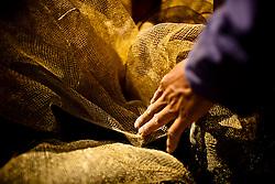 Detail of a hand holding fishing nets, Yen Bai Province, Vietnam, Southeast Asia