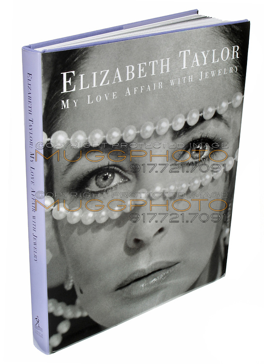 """Elizabeth Taylor """"My Love Affair with Jewelry"""" book photographed on a white background."""