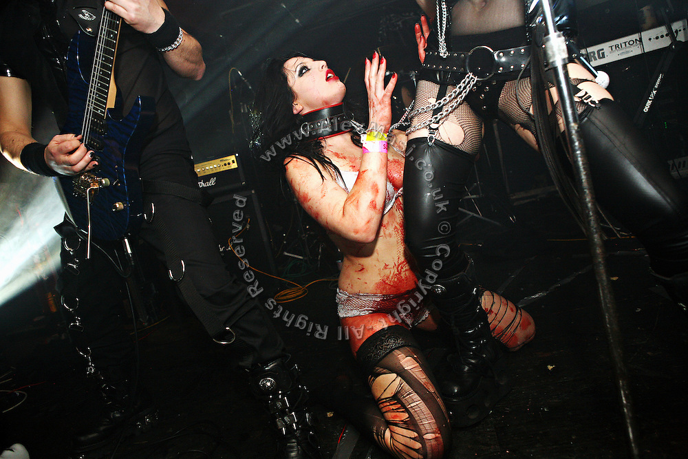 Stage scene during the Theatres des Vampires concert at the Slimelight, an exclusive Goth club in London during a night organised by the Vampyre Connexion, on Saturday, 3 February, 2007, in London, England. The Vampyre Connexion is the largest and most active of all the vampire groups in the United Kingdom, counting more than 100 members that for years have gathered regularly in London to share their common love for vampires and the Dark side of life. The Connexion raised from the hashes of the Vampyre Society, the first vampire appreciation group in 1995. The group believe in the fantasy of vampires and such creatures and live it to the full. Its  roots are to be found in the legends of Bram Stokerís Dracula. The group prints its own magazine, ëDark Nightsí featuring drawings, poetry, stories, photography and events. All of the members dress very peculiar clothing, and this is a very important part of the life of the group; it is respected with pride, taste and accuracy for the detail. Most like to dress to be elegant in a range of styles from regency to Victorian, some sew their own. In addition members visit art galleries, cemeteries, churches and cathedrals, attend gigs and concerts, and hold their own parties throughout the year, Halloween being the biggest and scariest one. Membership is open to all, the only qualification: being a love of all things Vampyric.**ItalyOut**