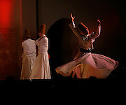 A Sufi whirling dervish during a rare, public ceremonial performance at the Bab Makina in Fes, Morocco during the annual Fes Festival of World Sacred Music on Monday, June 04, 2007. The festival is in the first week of June and has been a huge attraction for the city for thirteen years. These performers were from Turkey and practice Sufism, a sect that has evolved from Islam. (PHOTO BY TIMOTHY D. BURDICK).