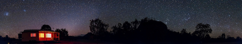 A 360° panorama of the southern sky, early evening, in early December 2012, from Timor Cottage, near Coonabarabran, NSW, Australia. The Magellanic Clouds are at left, the Zodiacal Light to the right of the cottage, the Zodiacal Band extending to the right over Timor Rock and into Taurus just above the Rock. The Pleiades and Jupiter are just above Timor Rock. Orion is to the right of the Rock, rising and upside down. The southern Milky Way in Puppis and Vela is just coming up at right. .This is an 8-section panorama taken with the Canon 60Da and 10-22mm lens at 10mm, at f/3.5 for 1 minute each at ISO 3200. Stitched with Photoshop CS6.