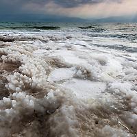 Israel, Drying shelf of salt left by receding water level along eroded shoreline of Dead Sea near Ein Gedi