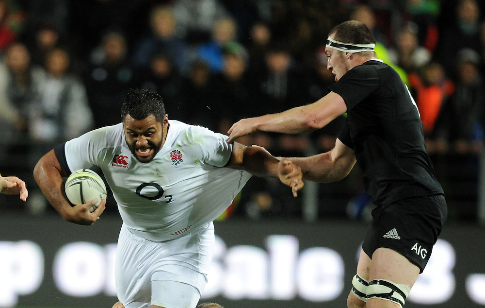 England's Billy Vunipola, left, held by New Zealand's Brodie Retallick in the third International Rugby Test at Waikato Stadium, Hamilton, New Zealand, Saturday, June 21, 2014. Credit:SNPA / Ross Setford