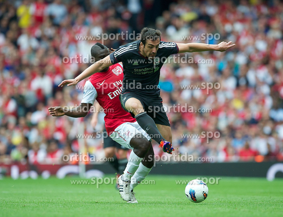 20.08.2011, Emirates Stadium, London, ENG, PL, FC Arsenal vs Liverpool FC, im Bild Liverpool's Jose Enrique in action against Arsenal's Emmanuel Frimpong during the Premiership match at the Emirates Stadium, EXPA Pictures © 2011, PhotoCredit: EXPA/ Propaganda/ D. Rawcliffe *** ATTENTION *** UK OUT!