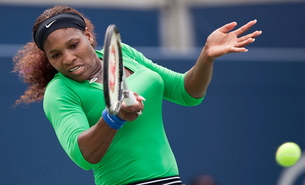 Serena Williams of the United States returns a shot during her victory over Samantha Stosur of Australia in the final at the Rogers Cup WTA event in Toronto, Ontario, August 14, 2011.<br /> AFP PHOTO/Geoff Robins