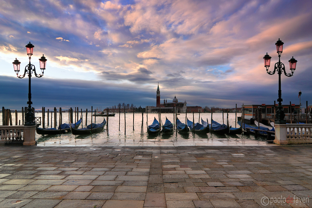 A glorious sunrise over San Giorgio Maggiore on a cold december morning, after a stormy and rainy night. Taken at dawn from Riva degli Schiavoni. This is a stitch of 4 verticals.