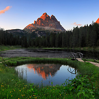 The Tre Cime di Lavaredo at sunset, from Lake Antorno