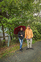 High school friends, Monce Padilla and Luis Vega walk home together on a rainy day in Calistoga.