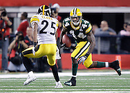 Green Bay Packers' James Starks rushes for 8-yards on 3rd and 1-yard in the 1st quarter. Pittsburgh Steelers' Ryan Clark looks to bring him down. .The Green Bay Packers played the Pittsburgh Steelers in Super Bowl XLV,  Sunday February 6, 2011 in Cowboys Stadium. Steve Apps-State Journal.