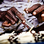 Hands of an old woman working in a matchstick factory. Image © Balaji Maheshwar/Falcon Photo Agency
