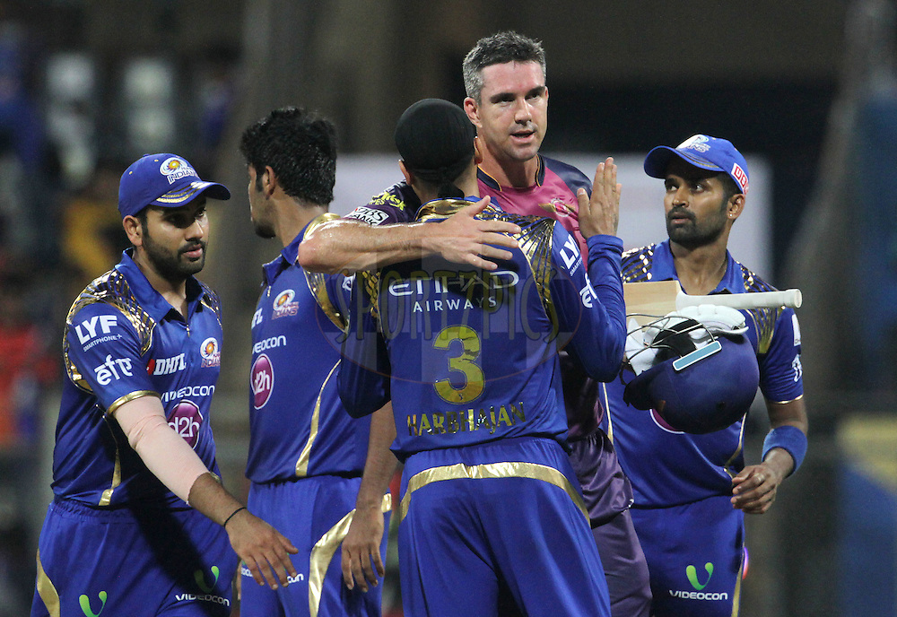 Rising Pune Supergiants player Kevin Pietersen hugs Mumbai Indians player Harbhajan Singh  after the match 1 of the Vivo Indian Premier League ( IPL ) 2016 between the Mumbai Indians and the Rising Pune Supergiants held at the Wankhede Stadium in Mumbai on the 9th April 2016<br /> <br /> Photo by Vipin Pawar/ IPL/ SPORTZPICS