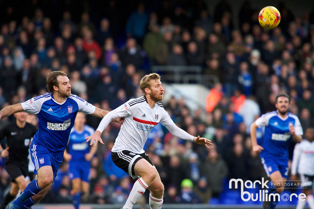 Ipswich, Suffolk. Football action from Ipswich Town v Fulham at Portman Road in the Sky Bet Championship on the 26th December 2016. Fulham's Tim Ream and Ipswich player Brett Pitman<br /> <br /> Picture: MARK BULLIMORE