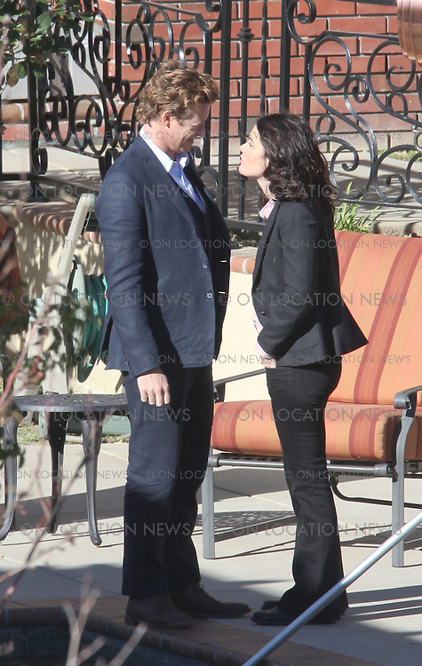 EXCLUSIVE January 12, 2009 Los Angeles, CA. Australian Hottie Simon Baker with co star Robin Tunney in between takes on the set of the hit television show  'The Mentalist'. Eric Ford/ On Location News 818-613-3955 info@onlocationnews.com