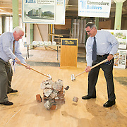 Medford Mayor Michael McGlynn, left, and Tufts President Anthony P. Monaco knock over a ceremonial pile of bricks at the groundbreaking ceremony for 574 Boston Ave. (Kelvin Ma/Tufts University)