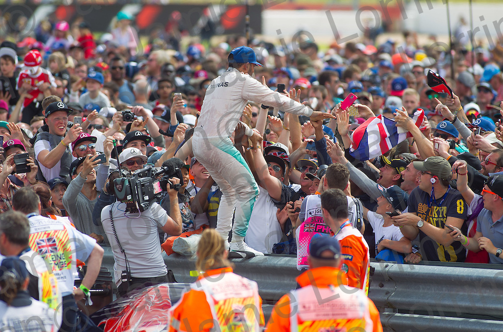 Race day at the 2016 Formula 1 British Grand Prix, Silverstone.<br /> <br /> Pictured: Lewis Hamilton is carried by the crowd after winning the British F1 Grand Prix.<br /> <br /> Jamie Lorriman<br /> mail@jamielorriman.co.uk<br /> www.jamielorriman.co.uk<br /> 07718 900288