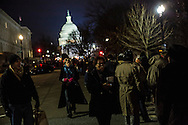 People wait in line near the U.S. Capitol to enter areas for ticketed guests ahead of President Barack Obama's inauguration on Monday, January 21, 2013 in Washington, DC.