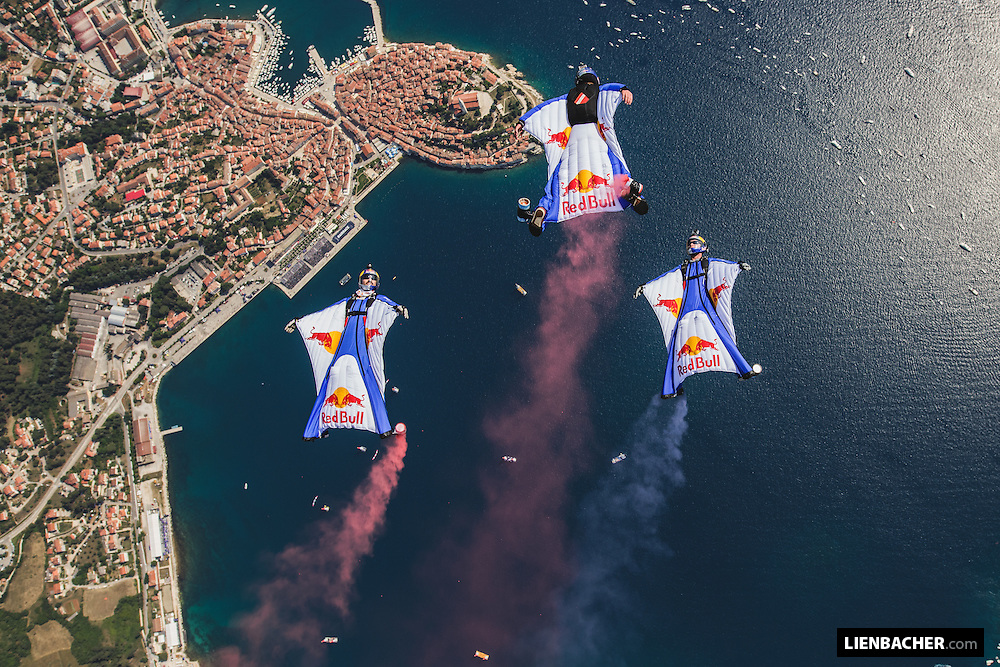 The Red Bull Skydive Team (Marco Waltenspiel, Marco Fuerst, Georg Lettner) performs a wingsuit flight at the Red Bull Airrace in Rovinj, Croatia. 31st of May 2015. Photo: Wolfgang Lienbacher