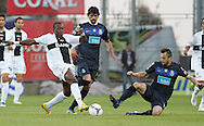 Portugal, FUNCHAL : Nacional's Angolan forward Mateus Costa (L) vies with Porto's Argentinian midfielder Lucho Gonzales (C) and Belgian midfielder Steven Defour (R) during their Portuguese football match at Madeira Stadium in Funchal on March 16, 2012. .PHOTO/ GREGORIO CUNHA.Estadio da Madeira, Funchal, Liga Portuguesa de futebol, Nacional vs Porto. .Mateus, Lucho e Defour.Foto Gregório Cunha