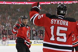 Apr 7; Newark, NJ, USA; New Jersey Devils left wing Ilya Kovalchuk (17) celebrates his goal with teammate New Jersey Devils right wing Petr Sykora (15) during the first period at the Prudential Center.