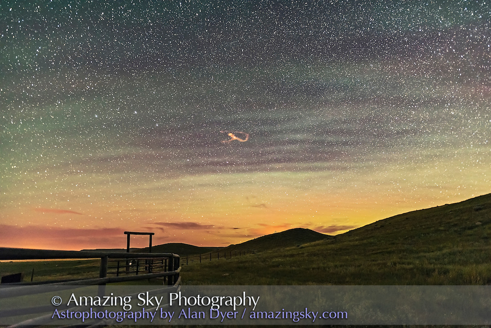 A long-lasting &ldquo;smoke&rdquo; or ion trail from a bright meteor in the Big Dipper, with a northern sky coloured by aurora and by green bands of airglow. Taken August 11, 2016, peak night of the Perseids, from 70 Mile Butte in Grasslands National Park, Saskatchewan, a dark sky preserve.<br /> <br /> This is a single 30-second exposure at f/1.4 with the 20mm Sigma Art lens, and Nikon D750 at ISO 3200.