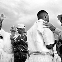 ..Volunteer counselors move in to pray with inmates on the yard at Coffield Prison near Palestine, Texas. Inmate Marlin Ray Theis, left, said he became a Christian a year earlier at the hands of another prison ministry.